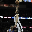 San Antonio Spurs' Kawhi Leonard, right, dunks over Los Angeles Clippers' Chris Paul during the first half of an NBA basketball game, Friday, March 29, 2013, in San Antonio. (AP Photo/Darren Abate)