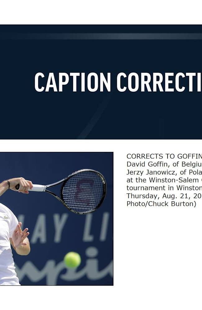 CORRECTS TO GOFFIN NOT GOFFEN  - David Goffin, of Belgium, returns a shot to Jerzy Janowicz, of Poland, in their match at the Winston-Salem Open tennis tournament in Winston-Salem, N.C., Thursday, Aug. 21, 2014