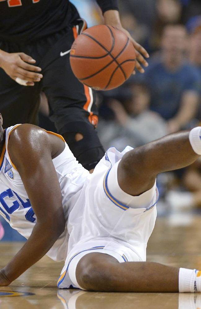 UCLA guard Jordan Adams falls as he drives toward the basket during the second half of an NCAA college basketball game against Oregon State, Sunday, March 2, 2014, in Los Angeles. UCLA won 74-69