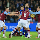 Leicester City's Matty James, center left, and Aston Villa's Ciaran Clark, no. 6, clash during the English Premier League soccer match to receive a red card each at the King Power Stadium, Leicester, England, Saturday Jan. 10, 2015