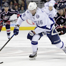Columbus Blue Jackets' James Wisniewski, right, chases Tampa Bay Lightning's Nikita Kucherov, of Russia, during the first period of an NHL hockey game Saturday, Nov. 8, 2014, in Columbus, Ohio The Associated Press