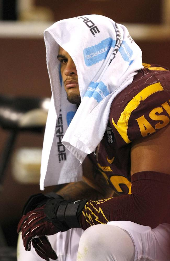 Arizona State linebacker Carl Bradford (52) sits on the side lines after getting into an altercation with head coach Todd Graham during the second half of an NCAA college football game against Oregon State on Saturday, Nov. 16, 2013, in Tempe, Ariz. The Sun Devils defeated the Beavers 30-17
