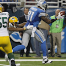 Detroit Lions wide receiver Calvin Johnson (81) pulls away from Green Bay Packers cornerback Tramon Williams (38) for a 20-yard touchdown run during the third quarter of an NFL football game at Ford Field in Detroit, Thursday, Nov. 28, 2013 The Associated