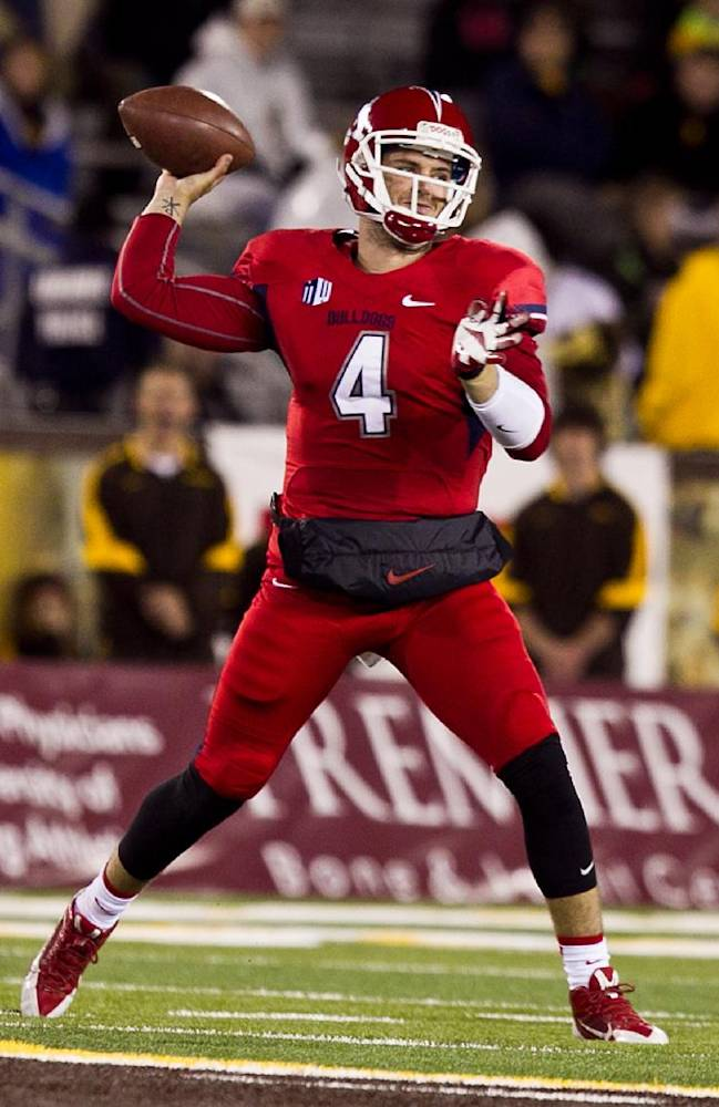 Fresno State quarterback Derek Carr (4) throws a pass past Wyoming Saturday Nov. 9, 213 during the first half of the game at War Memorial Stadium in Laramie, Wyo