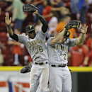 Pittsburgh Pirates outfielders Starling Marte (6), Travis Snider (23), and Andrew McCutchen celebrate after they defeated the Cincinnati Reds 4-0 in a baseball game, Tuesday, June 18, 2013, in Cincinnati. (AP Photo/Al Behrman)