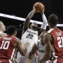 Michigan State's Branden Dawson (22) shoots over Oklahoma's Cameron Clark (21) and Jordan Woodard (10) during the first half of the championship game in the Coaches vs. Cancer NCAA college basketball game on Saturday, Nov. 23, 2013, in New York. (AP Photo/Frank Franklin II)