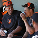 Baltimore Orioles' Nelson Cruz, left, take a break in the dugout with Manny Machado, center, after taking batting practice before an exhibition spring training baseball game in Sarasota, Fla., Saturday, March 1, 2014 The Associated Press