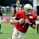 New Orleans Saints quarterback Luke McCown (7) looks to pass the ball during NFL football training camp in White Sulphur Springs, W.Va., Sunday, July 27, 2014 The Associated Press