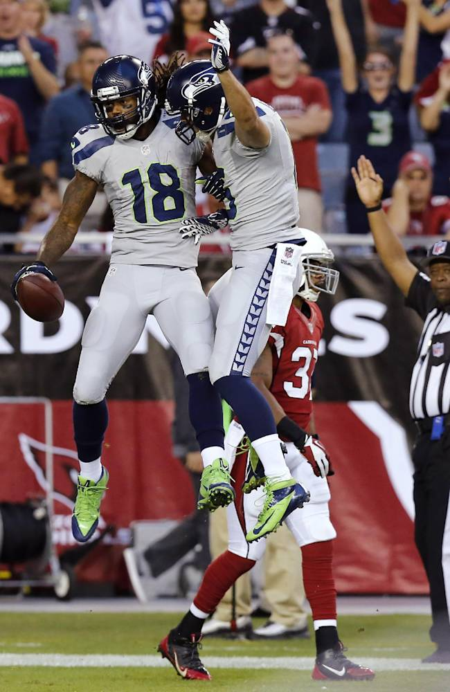 Seattle Seahawks wide receiver Sidney Rice (18) celebrates his touchdown with Jermaine Kearse, right, as Arizona Cardinals strong safety Yeremiah Bell, rear, walks away during the first half of an NFL football game, Thursday, Oct. 17, 2013, in Glendale, Ariz
