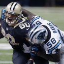 New Orleans Saints tight end Jimmy Graham (80) is tackled by Carolina Panthers outside linebacker Thomas Davis (58) in the first half of an NFL football game in New Orleans, Sunday, Dec. 7, 2014 The Associated Press