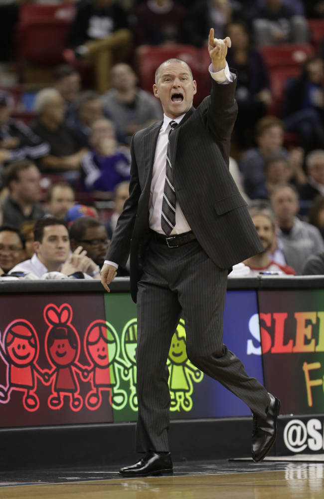 Sacramento Kings head coach Michael Malone calls out instructions to his team during the first quarter against the Portland Trail Blazers in an NBA basketball game in Sacramento, Calif., Tuesday, Jan. 7, 2014.  The Kings won 123-119