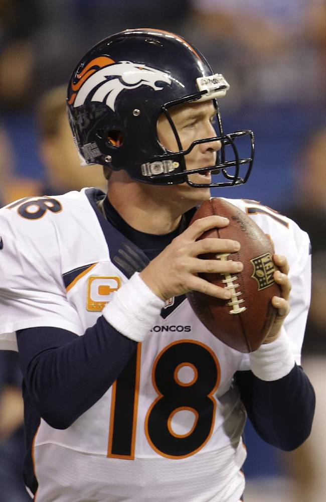 Sore ankle keeps Manning out of practice