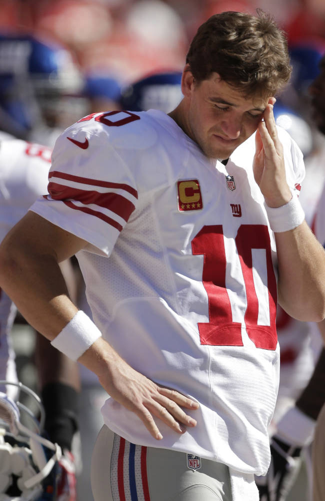 New York Giants quarterback Eli Manning (10) stands on the sideline during the second half of an NFL football game against the Kansas City Chiefs at Arrowhead Stadium in Kansas City, Mo., Sunday, Sept. 29, 2013