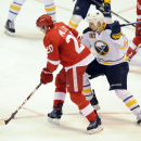 Detroit Red Wings left wing Drew Miller (20), left, turns to shoot and score a goal past Buffalo Sabres right wing Chris Stewart (80) during the second period of an NHL hockey game at Joe Louis Arena in Detroit, Sunday, Jan. 18, 2015 The Associated Press