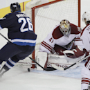 Winnipeg Jets' Blake Wheeler (26) attempts to jam the puck in the corner past Phoenix Coyotes goaltender Mike Smith (41) as Coyotes' Antoine Vermette (50) defends during first-period NHL hockey game action in Winnipeg, Manitoba, Thursday, Feb. 27, 2014 Th