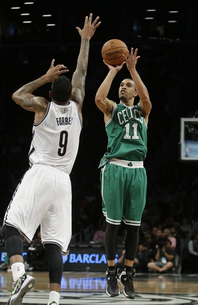 Boston Celtics' Courtney Lee (11) shoots over Brooklyn Nets' Gary Forbes (9) during the second half of a preseason NBA basketball game Tuesday, Oct. 15, 2013, in New York.  The Nets won 82-80