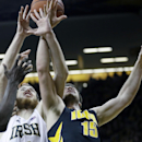 Notre Dame center Garrick Sherman, left, fights for a rebound with Iowa forward Zach McCabe during the second half of an NCAA college basketball game, Tuesday, Dec. 3, 2013, in Iowa City, Iowa The Associated Press