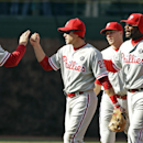 Philadelphia Phillies' Chase Utley (26), Ryan Howard (6) and Cody Asche celebrates with closer Jonathan Papelbon, left, after the Phillies defeated the Chicago Cubs 2-0 in a baseball game in Chicago, Saturday, April 5, 2014 The Associated Press