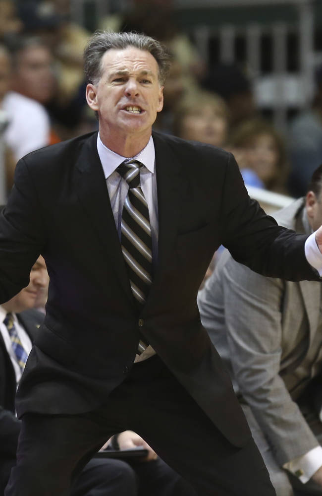 Pittsburgh coach Jamie Dixon yells instructions to his team during the overtime period of an NCAA college basketball game in Coral Gables, Fla., Wednesday, Feb. 5, 2014 against Miami. Pittsburgh won 59-55 in overtime