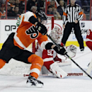 Philadelphia Flyers' Jakub Voracek (93), left, tries for a wraparound goal against Detroit Red Wings' Jonas Gustavsson (50) as Red Wings' Niklas Kronwall (55) also defends in the second period of an NHL hockey game Saturday, Oct. 25, 2014, in Philadelphia