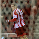 Sunderland's Adam Johnson celebrates his goal during their English Premier League soccer match against Tottenham Hotspur at the Stadium of Light, Sunderland, England, Saturday, Dec. 7, 2013