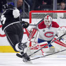 Los Angeles Kings defenseman Brayden McNabb shoots the puck at Montreal Canadiens goalie Dustin Tokarski during the first period of an NHL hockey game, Thursday, March 5, 2015, in Los Angeles. (AP Photo/Mark J. Terrill)