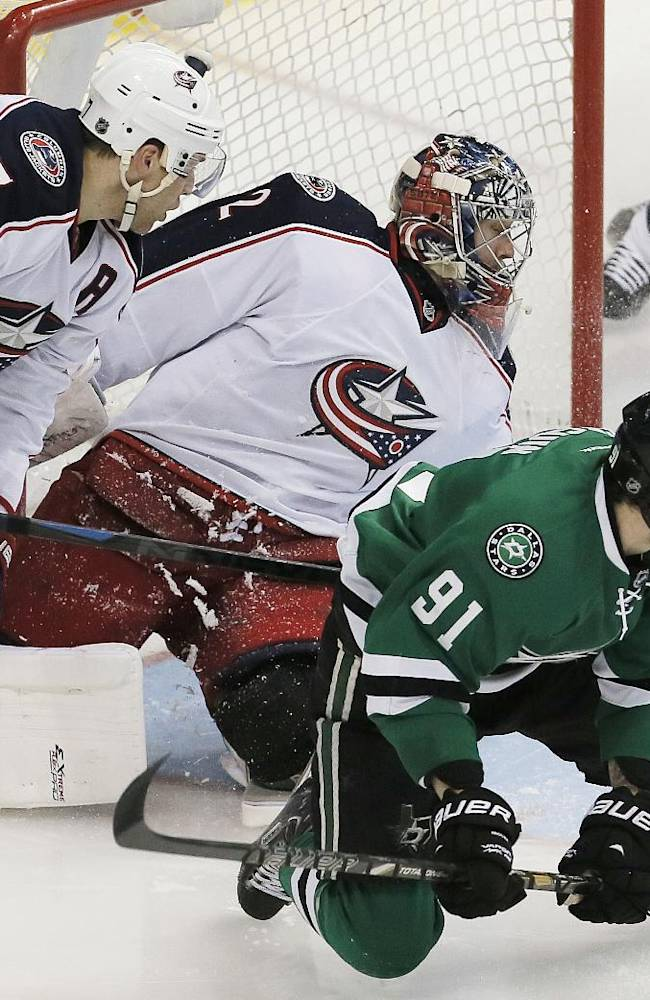 Dallas Stars forward Tyler Seguin (91) attempts to find the loose puck as Columbus Blue Jackets defenseman Jack Johnson (7) and goalie Sergei Bobrovsky (72) defend during the third period of an NHL hockey game on Wednesday, April 9, 2014, in Dallas. Columbus won 3-1
