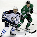 Winnipeg Jets defenseman Mark Stuart (5) and Dallas Stars center Colton Sceviour (22) watch the puck fly during the first period of an NHL hockey game, Monday, March 24, 2014, in Dallas The Associated Press