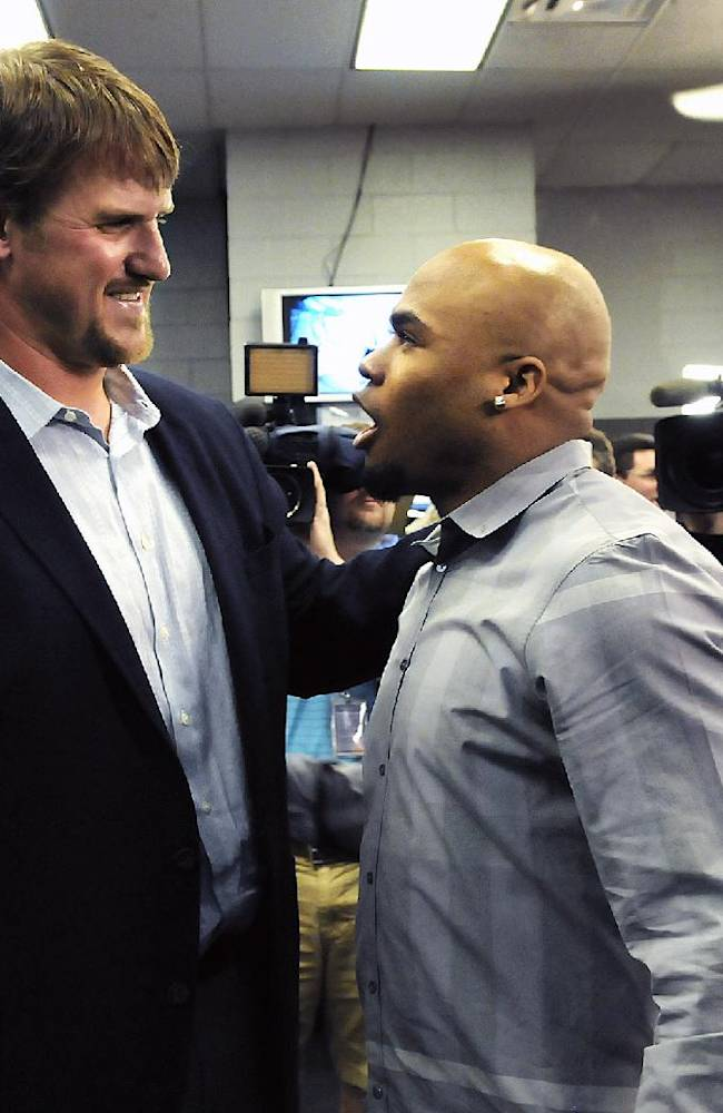 Carolina Panthers offensive tackle Jordan Gross greets now former teammate Steve Smith after Gross' news conference to announce his retirement after 11 seasons as a pro football player in Charlotte, N.C., Wednesday, Feb. 26, 2014