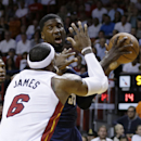 Indiana Pacers' Roy Hibbert (55) drives to the basket as Miami Heat's LeBron James (6) defends during the first half of an NBA basketball game, Friday, April 11, 2014, in Miami The Associated Press