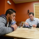 In a photo provided by ESPN, Notre Dame linebacker Manti Te'o pauses during an interview with ESPN's Jeremy Schaap, right, on Friday, Jan. 18, 2013, in Bradenton, Fla. ESPN says Te'o maintains he was never involved in creating the dead girlfriend hoax. He said in the off-camera interview: