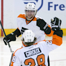 Philadelphia Flyers center Claude Giroux, back, skates to congratulate teammate Jakub Voracek on his goal during the second period of an NHL hockey game Tuesday, Nov. 12, 2013, in Ottawa, Ontario The Associated Press