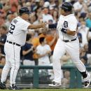 Detroit Tigers' Miguel Cabrera, right, is congratulated by third base coach Gene Lamont after hitting a solo home run in the fourth inning of a baseball game against the New York Yankees on Tuesday, Aug. 7, 2012, in Detroit. (AP Photo/Duane Burleson)