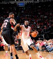 HOUSTON, TX - MARCH 9: James Harden #13 of the Houston Rockets drives against the Portland Trail Blazers on March 9, 2014 at the Toyota Center in Houston, Texas. (Photo by Bill Baptist/NBAE via Getty Images)