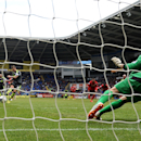 Stoke City's Marko Arnautovic scores his side's first goal of the game from the penalty spot, during the English Premier League match against Cardiff City, at the Cardiff City Stadium, Cardiff, Wales, Saturday, April 19, 2014