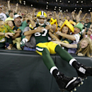 Green Bay Packers wide receiver Jordy Nelson (87) celebrates with fans after scoring a touchdown against the Oakland Raiders during the first half of an NFL preseason football game Friday, Aug. 22, 2014, in Green Bay, Wis The Associated Press