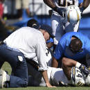 San Diego Chargers running back Ryan Mathews is helped after being injured during the second half of an NFL football game against the Seattle Seahawks, Sunday, Sept. 14, 2014, in San Diego. (AP Photo/Denis Poroy)