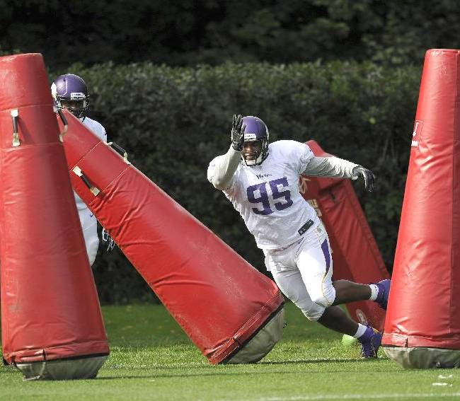 Vikings player Brian Robison practices with the tackle dummies during their football practice at the Grove Hotel in Watford, England, Thursday Sept. 26, 2013. The Pittsburgh Steelers are to play the Minnesota Vikings in the NFL International Series at Wembley Stadium in London on Sunday, Sept 29