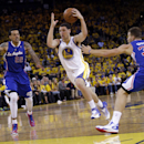 Golden State Warriors' Klay Thompson (11) dribbles between Los Angeles Clippers' Matt Barnes (22) and Blake Griffin (32) during the second half in Game 3 of an opening-round NBA basketball playoff series on Thursday, April 24, 2014, in Oakland, Calif. Los