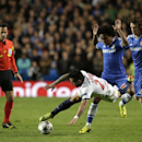 Paris Saint-Germain's Ezequiel Lavezzi, falls under pressure from Chelsea's David Luiz, right and Willian as referee Pedro Proenca looks and gave no foul during the Champions League quarterfinal second leg soccer match between Chelsea and Paris Saint Germ