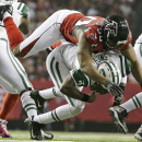 In this Oct. 7, 2013, file photo, New York Jets quarterback Geno Smith (7) is sacked by Atlanta Falcons defensive end Osi Umenyiora (50) during the second half of an NFL football game in Atlanta. Umenyiora still plays video games online with former Giants