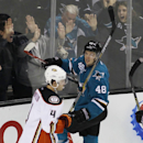 San Jose Sharks' Tomas Hertl (48) celebrates with fans after scoring a goal, as Anaheim Ducks' Brenden Dillon (4) skates by during the second period of an NHL hockey game, Saturday, Nov. 29, 2014, in San Jose, Calif The Associated Press