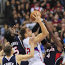 Los Angeles Clippers forward Blake Griffin (32) battles the triple coverage from Atlanta Hawks guard Kyle Korver (26), forward DeMarre Carroll (5) and forward Paul Millsap (4) as he drives to the basket in the second half of an NBA basketball game, Saturd