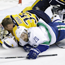 Vancouver Canucks left wing Chris Higgins (20) collides with Nashville Predators goalie Pekka Rinne (35), of Finland, in the first period of an NHL hockey game Tuesday, Jan. 13, 2015, in Nashville, Tenn. Higgins was called for goaltender interference The