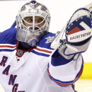 FILE - In this June 13, 2014, file photo, New York Rangers goalie Henrik Lundqvist, of Sweden, gloves the puck while playing the Los Angeles Kings during the second period in Game 5 of the NHL Stanley Cup Final series in Los Angeles. Roger Federer's long-time agent is branching out beyond tennis. The agency headed by Tony Godsick _ who has worked with 17-time major champion Federer for nearly a decade _ will represent Henrik Lundqvist for off-ice marketing deals. (AP Photo/Jae C. Hong, File)