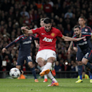 Manchester United's Robin van Persie scores a penalty for his side's first goal during their Champions League last 16 second leg soccer match at Old Trafford Stadium, Manchester, England, Wednesday, March 19, 2014