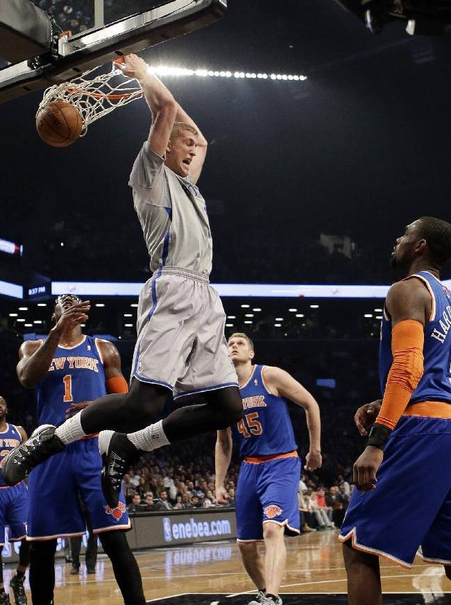 Brooklyn Nets' Mason Plumlee (1) dunks in front of New York Knicks' Tim Hardaway Jr. (5) during the first half of an NBA basketball game Tuesday, April 15, 2014, in New York