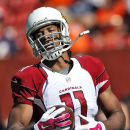 Arizona Cardinals wide receiver Larry Fitzgerald (11) warms up prior to an NFL football game against the Denver Broncos, Sunday, Oct. 5, 2014, in Denver The Associated Press