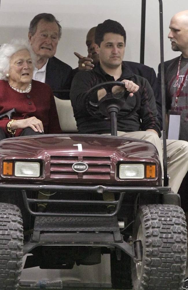 Former President George H.W. Bush and Barbara Bush, left, attend Texas A&M pro day for NFL football representativesin College Station, Texas, Thursday, March 27, 2014