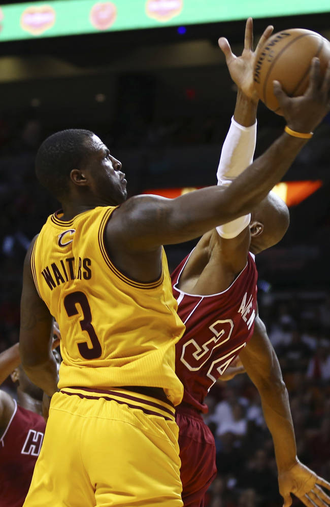MiamI Heat's Ray Allen (34) tries to block Cleveland Cavaliers' Dion Waiters (3) from making a two-point shot during the second half of an NBA basketball game in Miami, Saturday, Dec. 14, 2013. The Heat won 114-107